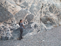 Lucy Chang poses by an impressive breccia