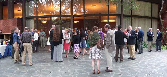 Guests gather outside the Alumni House