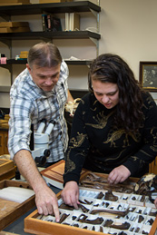 Eric Holt and Elyanah Posner examine cleaned-up McKittrick fossils