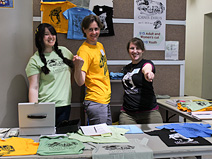 Holly Seyler, Renske Kirchholtes, and Jenny Hofmeister at the tee-shirt table