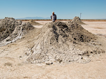 Ash contemplates one of the mud volcanoes