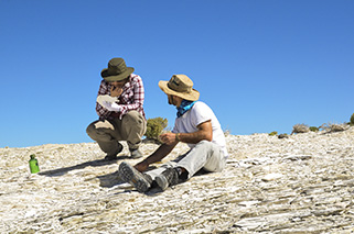 Cindy ponders a fossil that Daniel has found. Note the thinness of the individual diatomite layers.