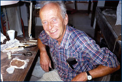Karl examines fossil eggshell at the University of Colorado Museum, 1987