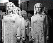 Huff with rows of his giant female figures