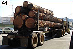 Lumber-laden truck rolls through Quincy