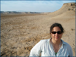 Lorraine with a 250,000-year-old uplifted coral terrace