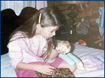 A young Jann with her pet hamster