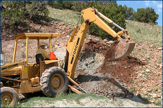 Virgil and the backhoe make short work of the overburden removal