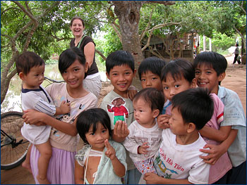 With children along the Mekong River