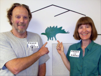 Martin Lockley and Karen Houck pointing to a Stegosaurus (the Colorado State Dinosaur) at the Denver Tracks Museum