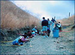 Families at the Blackhawk Fossil Dig, a community outreach activity at the Blackhawk Quarry, held during the 1990s