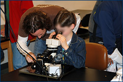 Brian Kraatz helps a young paleontologist find microfossils at the Cal Day