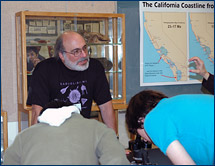 Ken Finger shows visitors California foraminiferans, past and present
