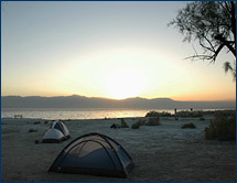 The sun sets on the group's campsite on the shores of the Salton Sea