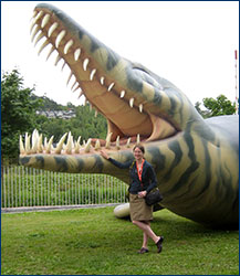 Emily Lindsey with a giant inflatable plesiosaur in front of the Oslo conference center.