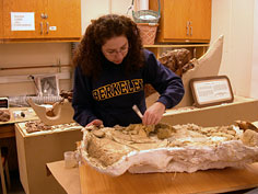 Leah does final cleaning of the incomplete pelvis