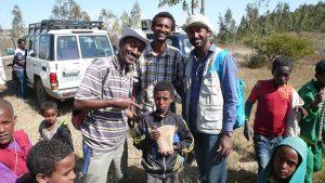 Million Alameyeho & Samuel Getachew (Addis Ababa U.) and Tadesse Berhanu (Oklahoma State U,) with local school kids