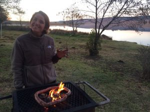 Marianne practices the art of braai, South African barbeque. Photo by Tesla Monson