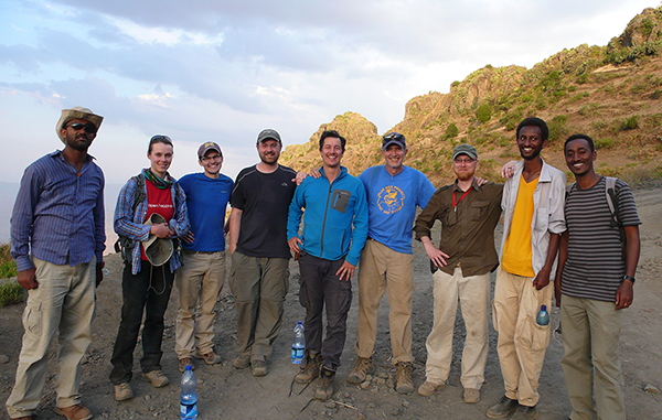 Group pic at the top of the flood basalts that cap the steep sided canyons of the Blue Nile Gorge, near Fiche, Ethiopia. From L to R: Tadesse Berhanu (PhD student, Oklahoma State); Connie Rasmussin (PhD student, Utah); Keegan Melstrom, PhD student, Utah); Randy Irmis (Utah); Greg Wilson (Washington); Mark Goodwin (UCMP); Dave Demar (Postdoc, Washington); Million Mengesha and Samuel (Earth Sciences Dept., Addis Ababa University).
