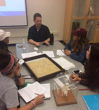 Lecturing on the use of fossils to understand the process of science. Photo courtesy of Briana McCarthy.