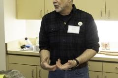 Graduate student Eric Holt explaining fossil prep.