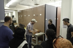 Graduate student Ash Poust leading a behind the scenes tour